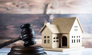 La afección real por las deudas a comunidad de propietarios en la adjudicación de inmuebles en concurso de acreedores